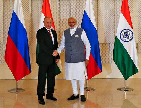 Russian President Vladimir Putin (L) shakes hand with India's Prime Minister Narendra Modi during a photo opportunity ahead of India-Russia Annual Summit in Benaulim, in the western state of Goa, India, October 15, 2016. REUTERS/Danish Siddiqui