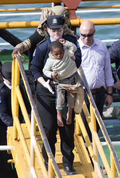 Migrants are disembarked from Turkish oil tanker El Hiblu 1, which was hijacked by migrants, in Valletta, Malta, Thursday March 28, 2019. A Maltese special operations team on Thursday boarded a tanker that had been hijacked by migrants rescued at sea, and returned control to the captain, before escorting it to a Maltese port. (AP Photo/Rene' Rossignaud)