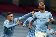 Raheem Sterling celebrates his goal for Manchester City against Arsenal