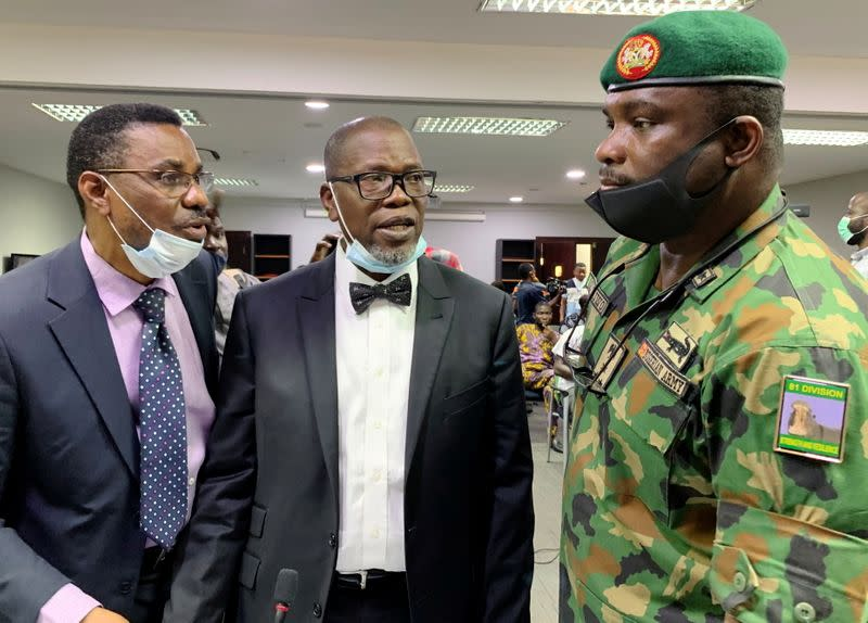 The counsel for the Nigerian Army, Akinlolu Kehinde, speaks to Brigadier General Ahmed Taiwo, during a judicial panel in Lagos