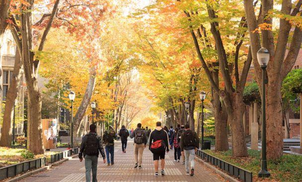 PHOTO: Students walk on the University of Pennsylvania campus. (Jon Lovette/Getty Images)