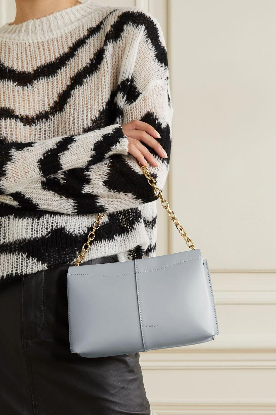 """<p>""""New year, new bag, right? I can't stop dreaming about the <span>Wandler Carly Mini Leather Shoulder Bag</span> ($530). The sleek silhouette, double interior pocket, and cool chain strap ticks every box on my cool new bag wish list. I can already envision myself wearing it with sweaters and dresses for the rest of the year."""" - KJ</p>"""