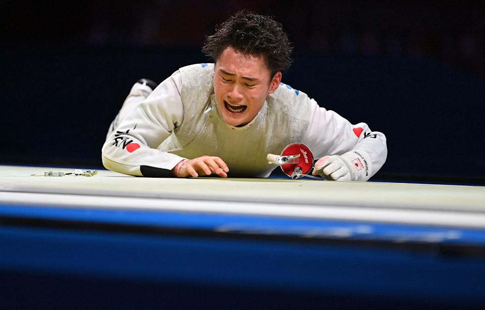 <p>Japan's Kyosuke Matsuyama reacts after loosing against Italy's Daniele Garozzo in the mens individual foil qualifying bout during the Tokyo 2020 Olympic Games at the Makuhari Messe Hall in Chiba City, Chiba Prefecture, Japan, on July 26, 2021. (Photo by Fabrice COFFRINI / AFP) (Photo by FABRICE COFFRINI/AFP via Getty Images)</p>