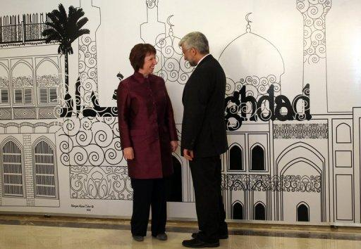 """Iran's chief nuclear negotiator and head of Iran's national security council Saeed Jalili (R) chats European Union foreign policy chief, Catherine Ashton, before a meeting in Baghdad on May 23. Tehran has """"no reason"""" to suspend its enrichment of uranium to 20 percent, one of the key demands of world powers engaging Iran in talks, the head of its Atomic Energy Organisation said late Saturday"""