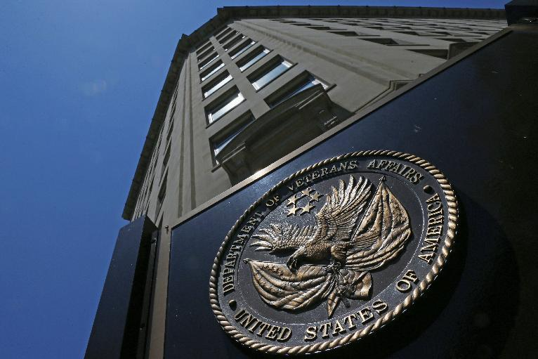 The seal a fixed to the front of the Department of Veterans Affairs building in Washington, Friday, June 21, 2013. The number of military suicides is nearly double that of a decade ago when the U.S. was just a year into the Afghan war and hadn't yet invaded Iraq. While the pace is down slightly this year, it remains worryingly high. The U.S. military and the Department of Veterans Affairs (VA) acknowledge the grave difficulties facing active-duty and former members of the armed services who have been caught up in the more-than decade-long American involvement in wars in Iraq and Afghanistan. (AP Photo/Charles Dharapak)