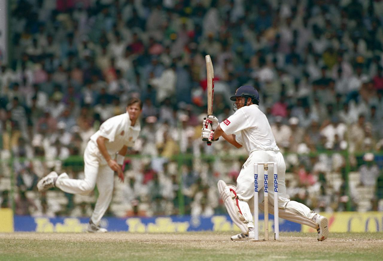 CHENNAI - MARCH 9:  Sachin Tendulkar of India hits out on his way to 155 runs during the Border-Gavaskar Trophy, 1997/98, 1st Test Match between India and Australia held on March 9, 1998 at the MA Chidambaram Stadium, in Chepauk, Chennai, India. (Photo by Ben Radford/Getty Images)