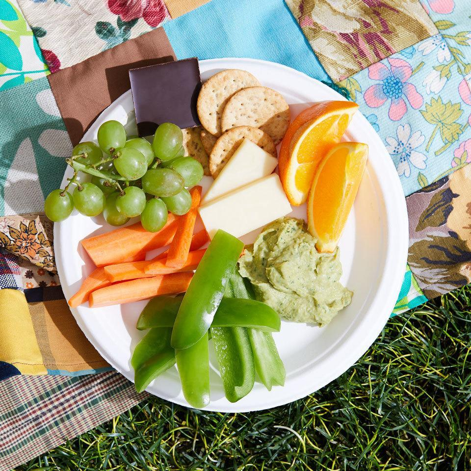 """<p>This healthy fruit, veggie and cheese plate is easy and affordable to pull together for a fun snack-style dinner at home or can be packed up and enjoyed as an outdoor picnic. <a href=""""https://www.eatingwell.com/recipe/264515/fruit-veggie-cheese-plate/"""" rel=""""nofollow noopener"""" target=""""_blank"""" data-ylk=""""slk:View Recipe"""" class=""""link rapid-noclick-resp"""">View Recipe</a></p>"""