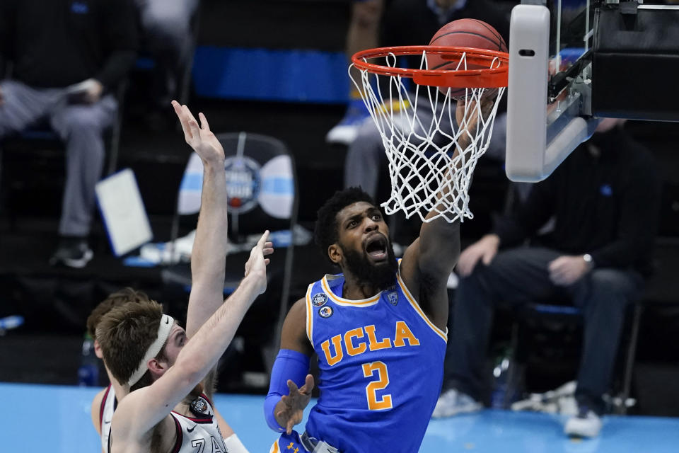 UCLA forward Cody Riley drives to the basket ahead of Gonzaga forward Drew Timme, left, during the second half of a men's Final Four NCAA college basketball tournament semifinal game, Saturday, April 3, 2021, at Lucas Oil Stadium in Indianapolis. (AP Photo/Darron Cummings)