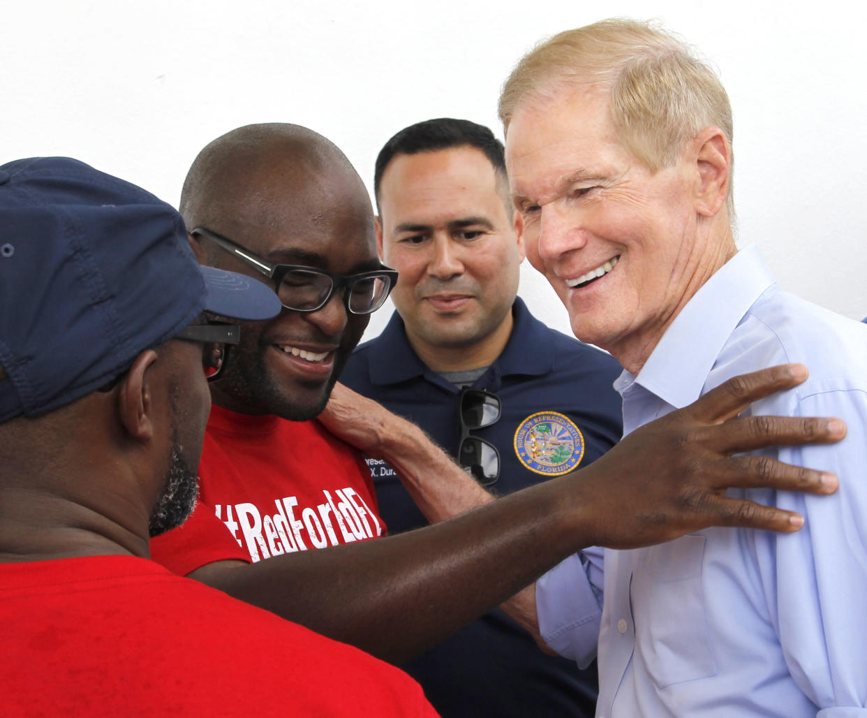 Sen. Bill Nelson, right, is greeted by educators at the Betty Anderson Rec Center in Miami Gardens, Fla., in August. (Photo: Carl Juste/Miami Herald/TNS via Getty Images)