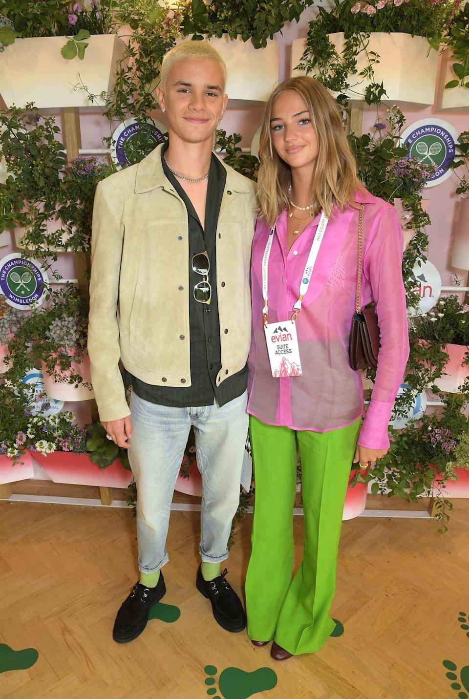 <p>Romeo Beckham attended day one of the tournament with his model girlfriend Mia Regan, who wore acid brights. </p>