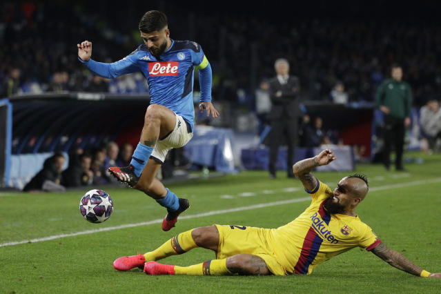 Napoli's Lorenzo Insigne, left, and Barcelona's Arturo Vidal vie for the ball during the Champions League, Round of 16, first-leg soccer match between Napoli and Barcelona, at the San Paolo Stadium in Naples, Italy, Tuesday, Feb. 25, 2020. (AP Photo/Andrew Medichini)
