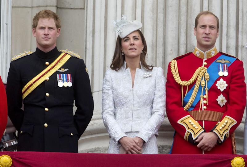Prince Harry, Catherine Duchess of Cambridge and Prince William Duke of Cambridge stand on the balcony during Trooping the Colour at The Royal Horseguards on June 14, 2014 in London, England.