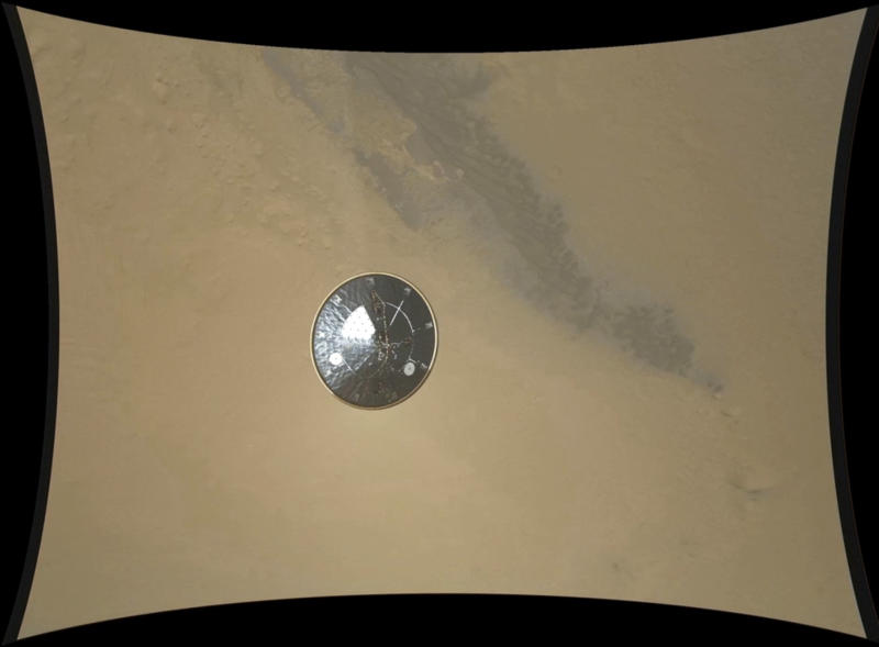 In this frame of a high definition stop motion video taken during the NASA rover Mars landing provided by the space agency on Thursday, Aug. 23, 2012, the heat shield falls away during Curiosity's descent to the surface of Mars on Sunday, Aug. 5, 2012. Curiosity is the first spacecraft to record a landing on another planet. The six-wheel rover arrived on Aug. 5 to begin a two-year mission to examine whether the Martian environment was hospitable for microbial life. (AP Photo/NASA/JPL-Caltech/MSSS)