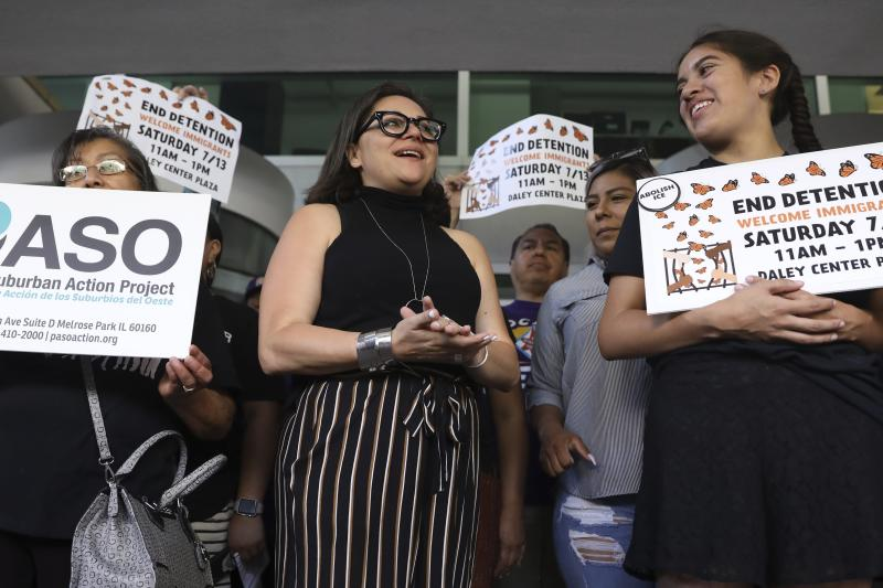 Mony Ruiz-Velasco, center, director of PASO West Suburban Action Project, chants with demonstrators following a new conference outside the U.S. Citizenship and Immigration Services offices in Chicago, Thursday, July 11, 2019. A nationwide immigration enforcement operation targeting people who are in the United States illegally is expected to begin this weekend. (AP Photo/Amr Alfiky)