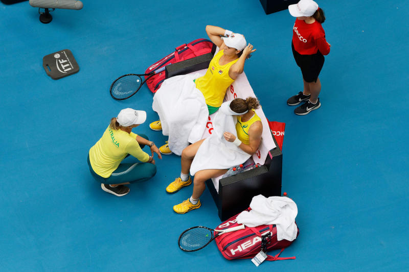 Australian captain Alicia Molik urges her players Ash Barty and Sam Stosur during a points break in their Fed Cup tennis final in Perth, Australia, Sunday, Nov. 10, 2019. (AP Photo/Trevor Collens)