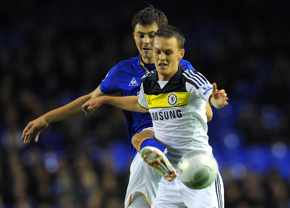 """Everton's Russian midfielder Diniyar Bilyaletdinov (L) vies with Chelsea's English midfielder Josh McEachran during the League Cup football match between Everton and Chelsea at Goodison Park in Liverpool on October 26 2011. AFP PHOTO/ANDREW YATES RESTRICTED TO EDITORIAL USE. No use with unauthorized audio, video, data, fixture lists, club/league logos or """"live"""" services. Online in-match use limited to 45 images, no video emulation. No use in betting, games or single club/league/player publications. (Photo credit should read ANDREW YATES/AFP via Getty Images)"""