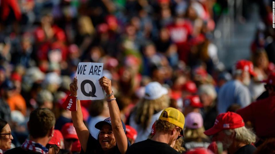 """<p>A woman holds up a QAnon sign at a President Trump campaign rally on September 22, 2020, in Moon Township, Pennsylvania. </p><div class=""""cnn--image__credit""""><em><small>Credit: Jeff Swensen/Getty Images / Getty</small></em></div>"""