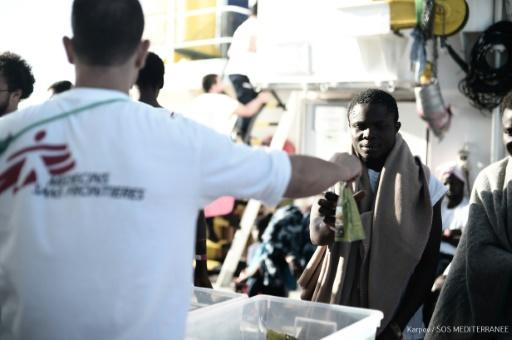 Exhausted and thirsty, more than 600 migrants are crowded on the Aquarius rescue ship