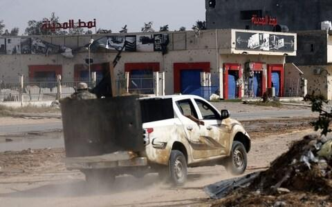 A vehicle belonging to Libyan fighters loyal to the Government of National Accord (GNA) is pictured during clashes with forces loyal to strongman Khalifa Haftar south of the capital Tripoli's suburb of Ain Zara - Credit: MAHMUD TURKIA/AFP