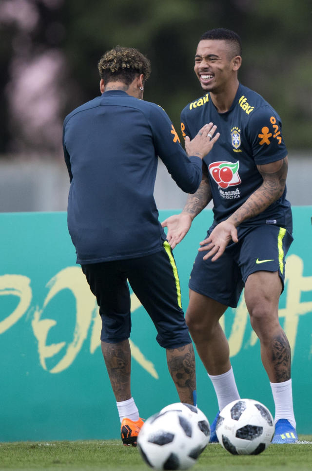 Brazil's Neymar, left, and Gabriel Jesus play around during a practice session of the Brazilian national soccer team ahead the World Cup in Russia, at the Granja Comary training center in Teresopolis, Brazil, Thursday, May 24, 2018. (AP Photo/Silvia Izquierdo)