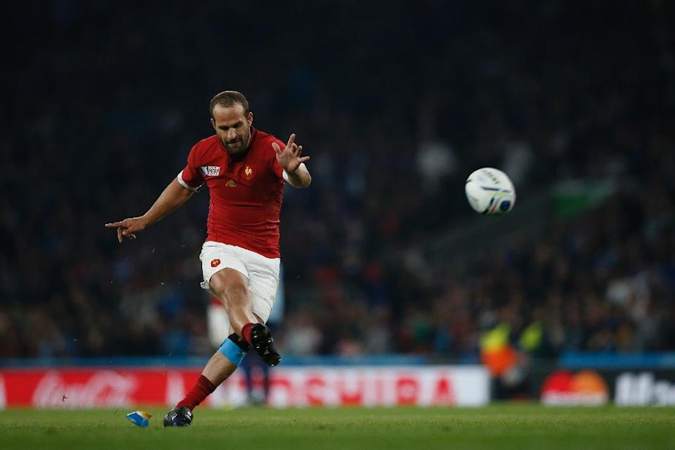 French fly half Frederic Michalak successfully kicks a conversion during the Rugby World Cup Pool D match against Italy at Twickenham stadium on September 19, 2015 (AFP Photo/Adrian Dennis)