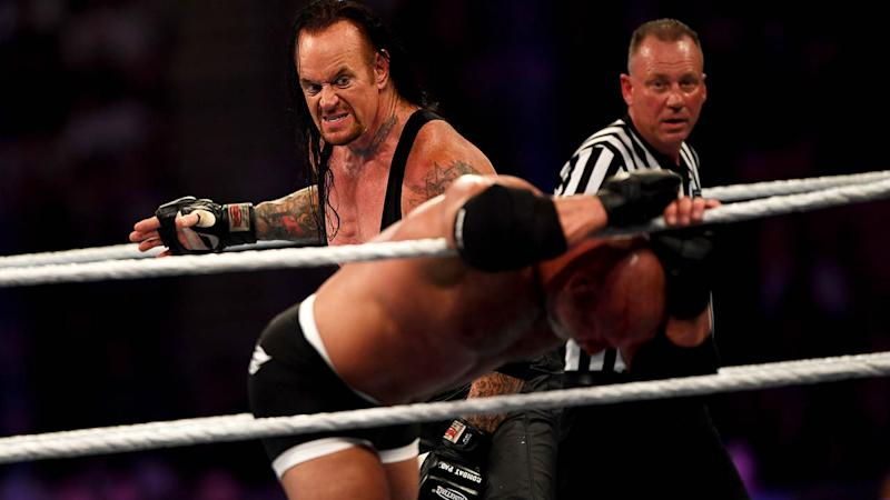The Undertaker competes against Goldberg during the Super Showdown. (Photo by AMER HILABI/AFP/Getty Images)