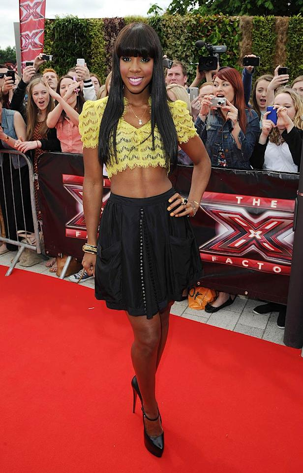 """Speaking of neon no-nos, check out the unsightly, lace Twenty8Twelve crop top former Destiny's Child member Kelly Rowland wore to the latest round of """"X Factor"""" auditions in Birmingham, England. I love her, but doesn't it seem like she's trying just a bit too hard? Eamonn McCormack/<a href=""""http://www.wireimage.com"""" target=""""new"""">WireImage.com</a> - June 1, 2011"""