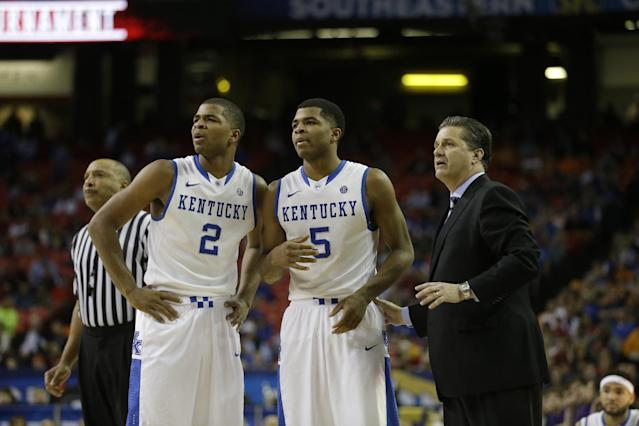 Kentucky head coach John Calipari speaks to players Aaron Harrison (2) and Andrew Harrison (5) during the second half of an NCAA college basketball game against LSU in the quarterfinal round of the Southeastern Conference men's tournament, Friday, March 14, 2014, in Atlanta. (AP Photo/Steve Helber)