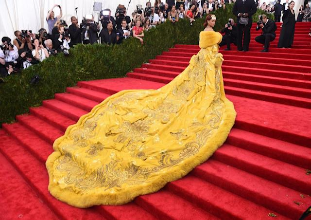 """<p>In what's considered one of the top Met looks ever, Rihanna tuned heads at the 2015 Met Gala, titled """"China: Through the Looking Glass."""" The icon wore an intricate yellow cape by <a href=""""https://www.crfashionbook.com/culture/a19482214/guo-pei-new-couture-book/"""" rel=""""nofollow noopener"""" target=""""_blank"""" data-ylk=""""slk:Chinese designer Guo Pei"""" class=""""link rapid-noclick-resp"""">Chinese designer Guo Pei</a> that took over two years to make. The pop star even had a band of men helping her carry her epic train. The subsequent year, Pei became the first Chinese designer invited into the Chambre Syndical de la Haute Couture. """"The international fashion industry gained a new understanding of me"""" Pei said following the event. </p>"""