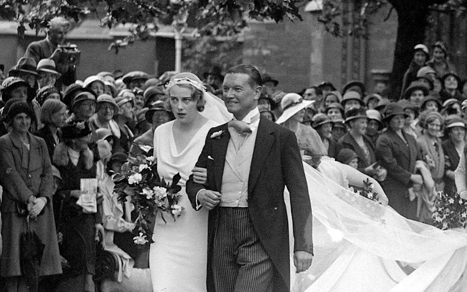 Lady Honor Guinness and Chips Cannon on their wedding day; London, 1933 - TopFoto