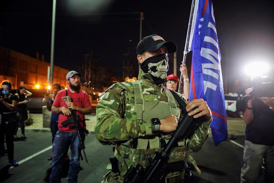 Supporters of U.S. President Donald Trump carry semi-automatic rifles as they gather during a protest about the early results of the 2020 presidential election, in front of the Maricopa County Tabulation and Election Center (MCTEC), in Phoenix, Arizona, U.S., November 5, 2020. (Jim Urquhart/Reuters)
