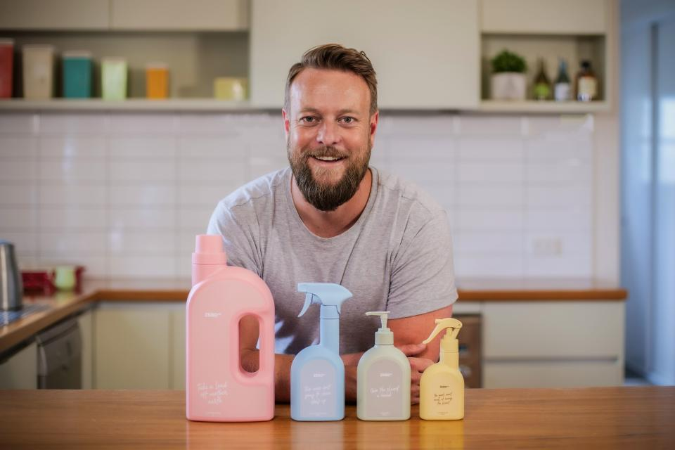 Pictured is Sydney man Mike Smith with four of Zero Co's containers.