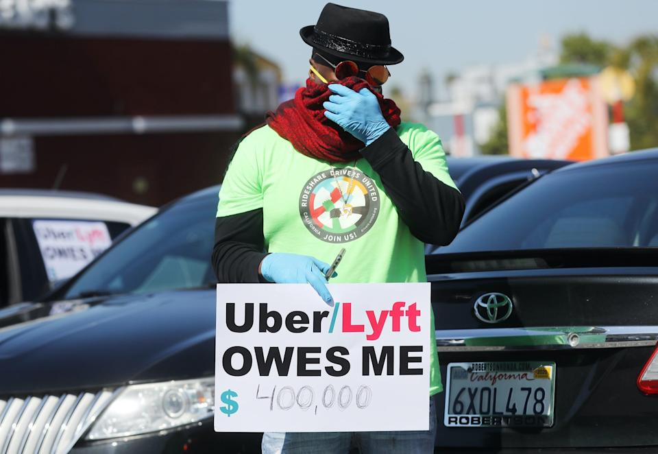 uber lyft protest drivers LOS ANGELES, CALIFORNIA - APRIL 16: A protestor displays a sign as Uber and Lyft drivers with Rideshare Drivers United and the