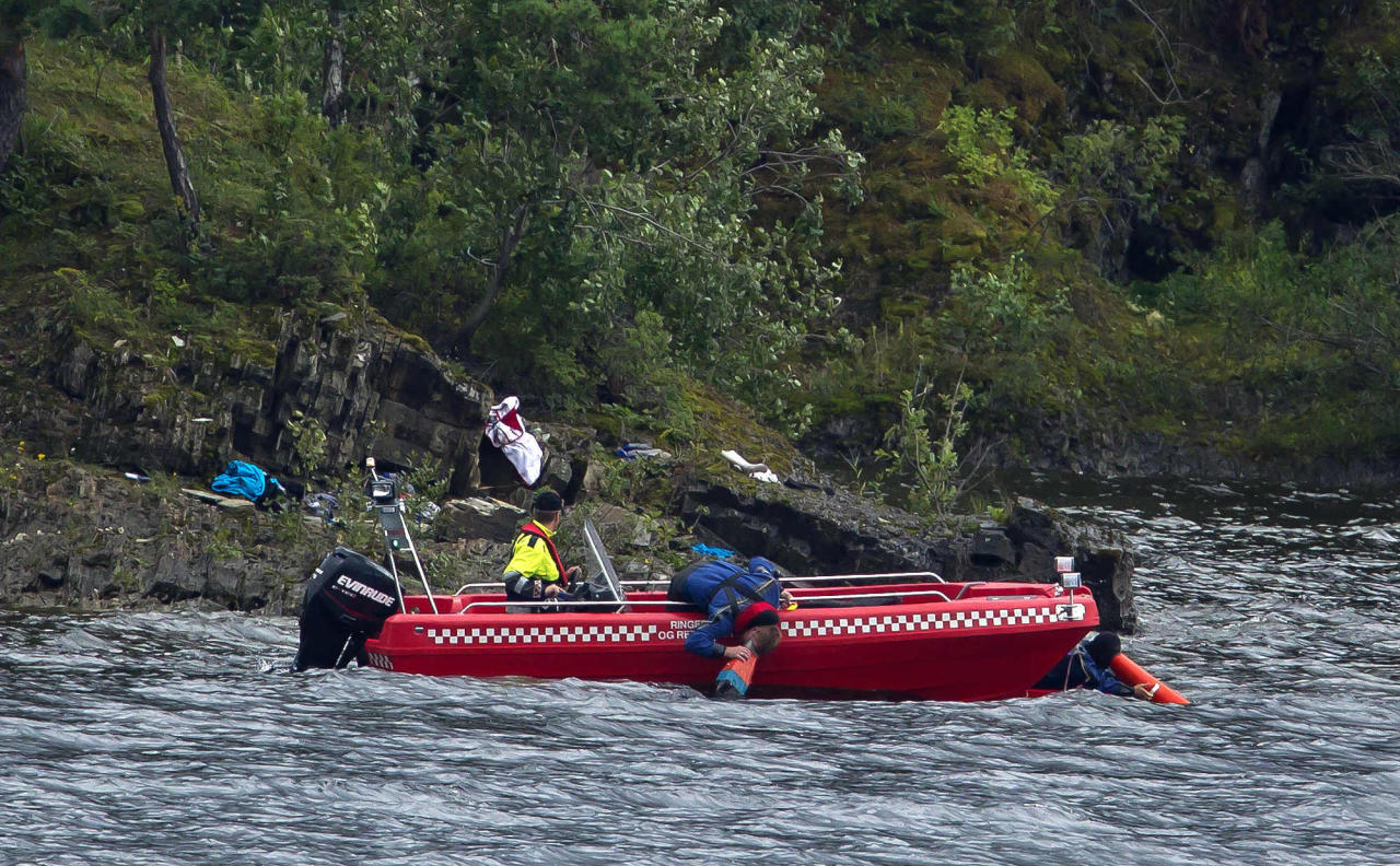 Emergency workers search for bodies beneath the water off the island of Utoya, Saturday, July 23, 2011. A Norwegian dressed as a police officer gunned down at least 84 people at an island youth retreat before being arrested, police said Saturday. Investigators are still searching the surrounding waters, where people fled the attack, which followed an explosion in nearby Oslo that killed seven. The mass shootings are among the worst in history. With the blast outside the prime minister's office, they formed the deadliest day of terror in Western Europe since the 2004 Madrid train bombings killed 191. (AP Photo/Matt Dunham)