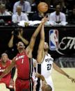 Miami Heat's Chris Bosh and San Antonio Spurs' Tim Duncan compete for the ball at tip off of Game 3 in their NBA Finals basketball series, Tuesday, June 11, 2013, in San Antonio. (AP Photo/David J. Phillip)
