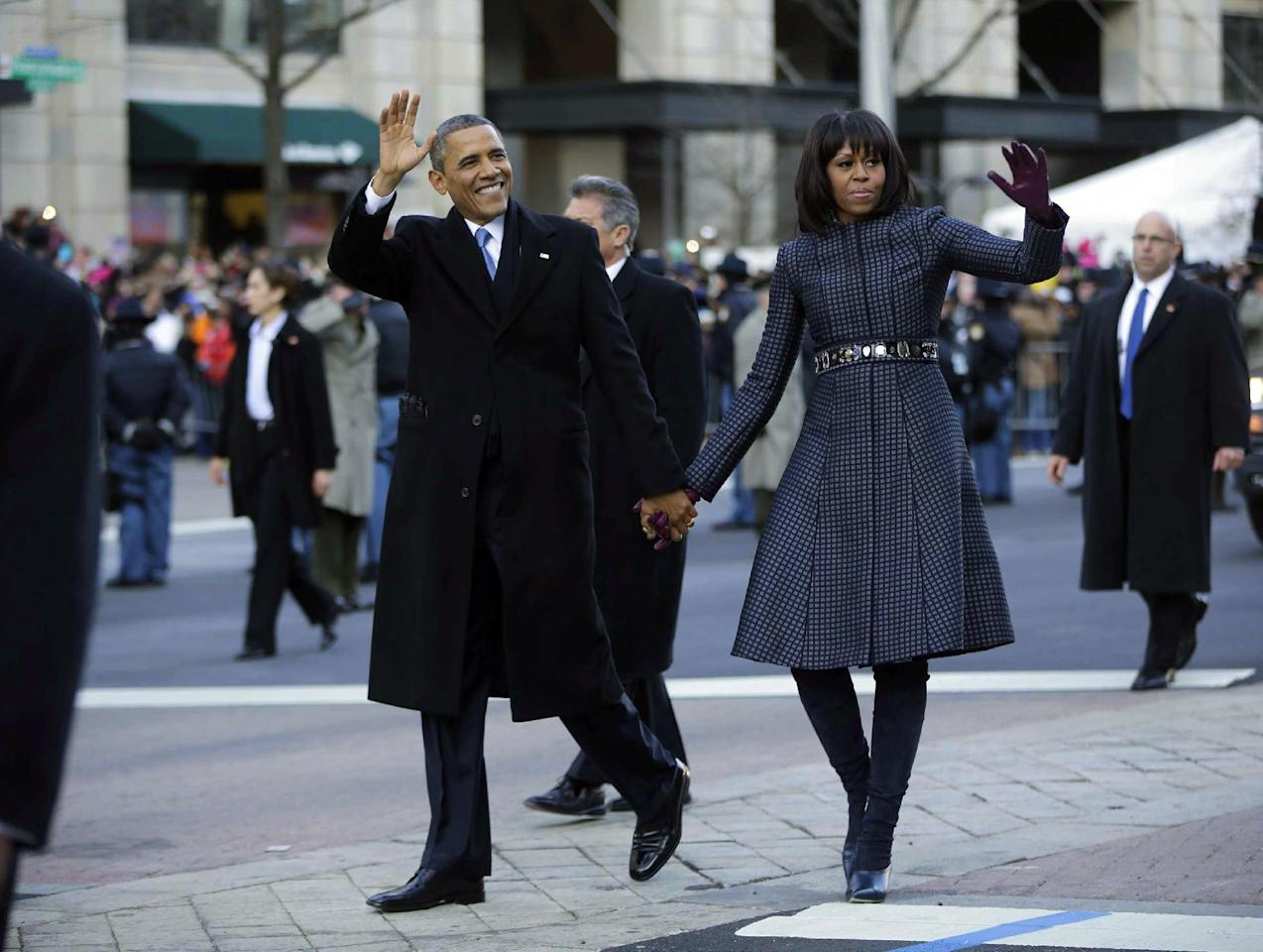 President Barack Obama and first lady Michelle Obama walk down Pennsylvania Avenue during the 57th Presidential Inauguration parade Monday, Jan. 21, 2013, in Washington. (AP Photo/Charles Dharapak)