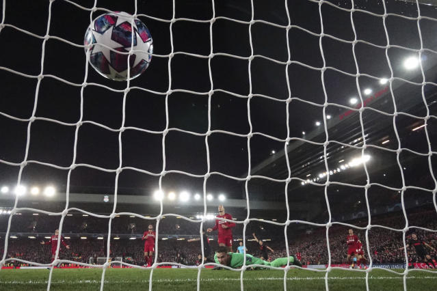 Liverpool's goalkeeper Adrian, center bottom, fails to save the ball as Atletico Madrid's Marcos Llorente scores his side's second goal during a second leg, round of 16, Champions League soccer match between Liverpool and Atletico Madrid at Anfield stadium in Liverpool, England, Wednesday, March 11, 2020. (AP Photo/Jon Super)