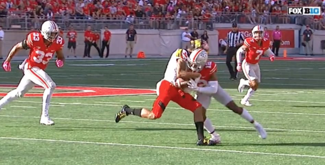 "Ohio State's <a class=""link rapid-noclick-resp"" href=""/ncaaf/players/254912/"" data-ylk=""slk:Denzel Ward"">Denzel Ward</a> was ejected after a vicious hit that was ruled for targeting. (Screen shot via Fox)"