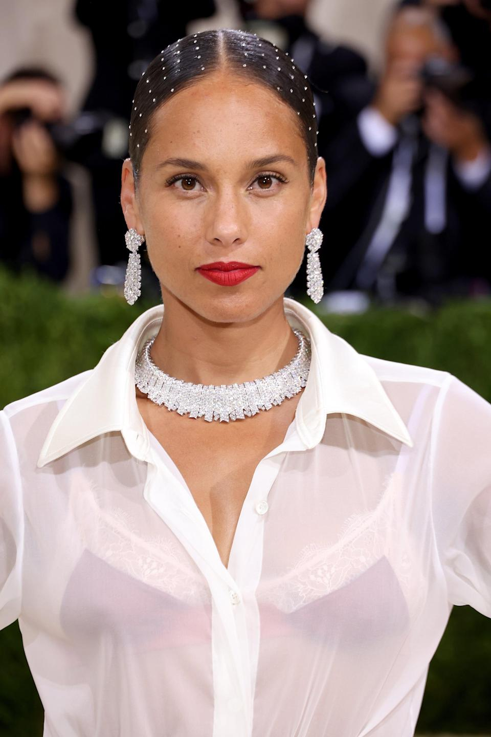 """<p><a class=""""link rapid-noclick-resp"""" href=""""https://www.popsugar.com/Alicia-Keys"""" rel=""""nofollow noopener"""" target=""""_blank"""" data-ylk=""""slk:Alicia Keys"""">Alicia Keys</a>'s 2021 Met Gala look fully made us want to embellish our entire head. Hairstylist and curl expert Nai'vasha worked with Keys to create this beautiful Swarovski crystal-encrusted chignon. """"A Royal ode to classic American glamour,"""" Nai'vasha <a href=""""https://www.instagram.com/p/CTyGWq0oseK/"""" class=""""link rapid-noclick-resp"""" rel=""""nofollow noopener"""" target=""""_blank"""" data-ylk=""""slk:captioned her Instagram post."""">captioned her Instagram post.</a></p>"""