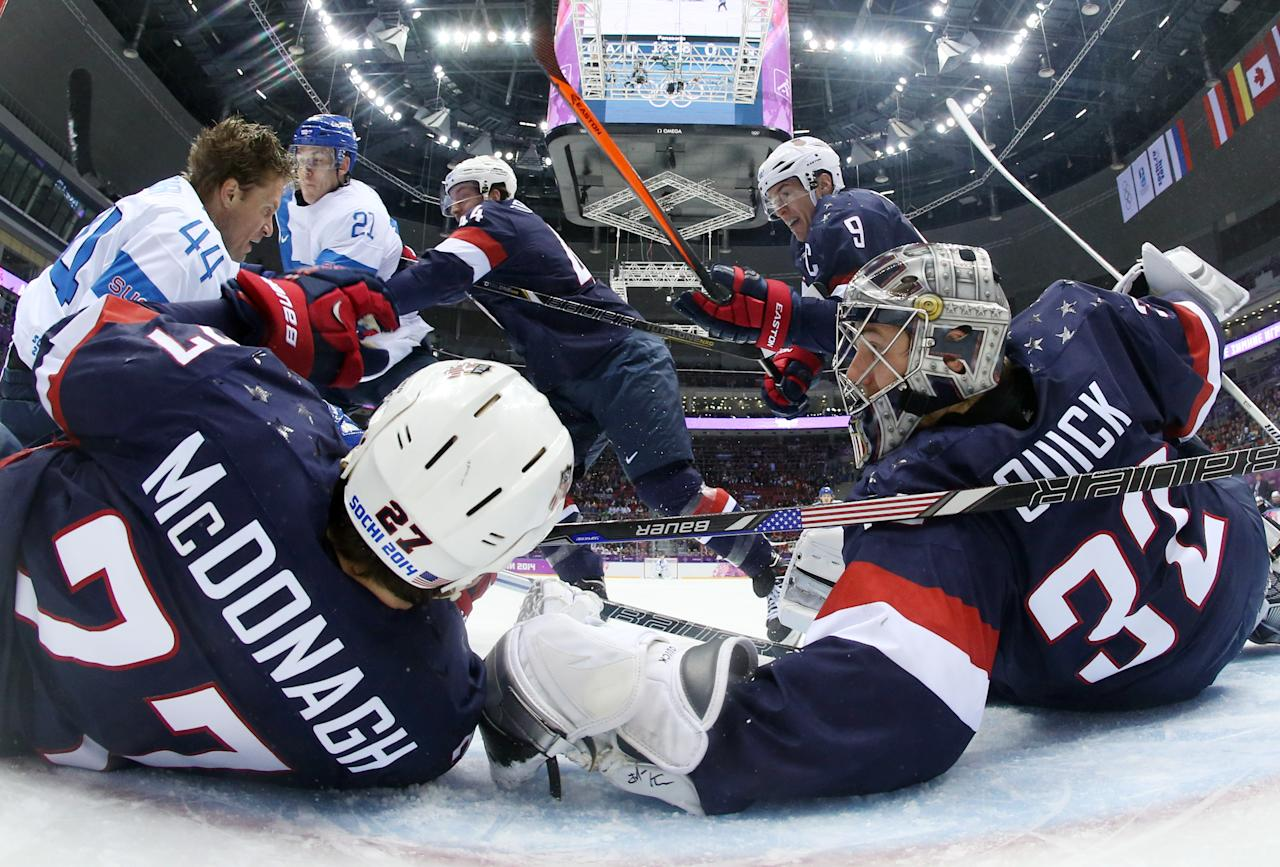 USA goaltender Jonathan Quick and defenseman Ryan McDonagh (27) block a shot by Finland defenseman Kimmo Timonen during the men's bronze medal ice hockey game at the 2014 Winter Olympics, Saturday, Feb. 22, 2014, in Sochi, Russia. (AP Photo/Bruce Bennett, Pool)