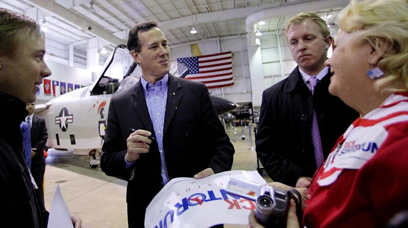 Republican presidential candidate, former Pennsylvania Sen. Rick Santorum visits with supporters during a rally at the Battleship Memorial Park, Friday, March 9, 2012, in Mobile, Alabama. (AP Photo/Eric Gay)