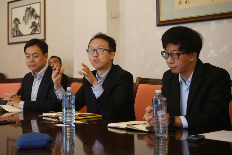 In this Sept. 24, 2019, photo, from left, Renmin University of China experts on international relations Wang Yiwei, Chen Xiaochen and Chen Hong, the head of Australian studies at East China Normal University, hold a press conference in the Chinese Embassy in Canberra, Australia. China sent the three scholars to spell out in interviews with Australian media and other appearances steps needed to mend the deepening rift with Beijing. (AP Photo/Rod McGuirk)