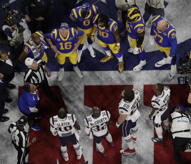 <p>Referee John Parry and players watch the coin toss before the NFL Super Bowl 53 football game between the Los Angeles Rams and the New England Patriots Sunday, Feb. 3, 2019, in Atlanta. (AP Photo/Morry Gash) </p>