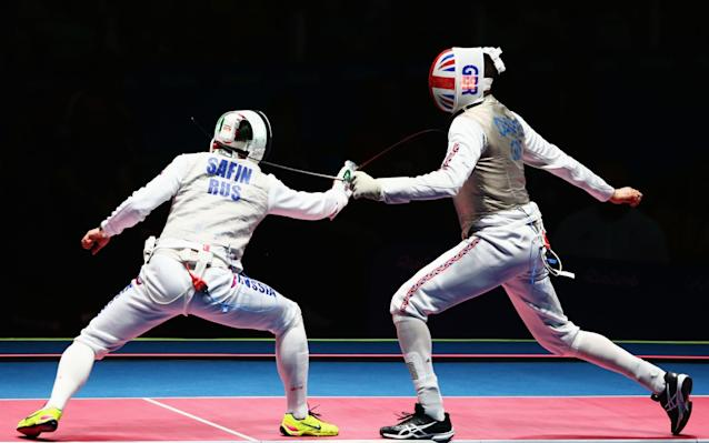 <span>Davis is coaching fencing in order to fund his expensive dream</span> <span>Credit: getty images </span>