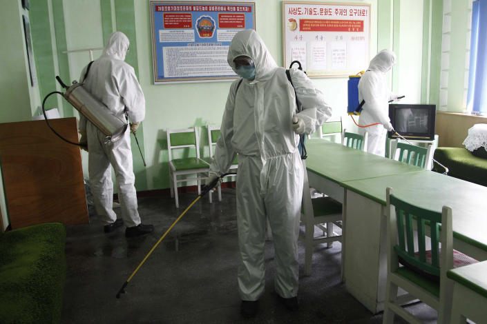 FILE - In this April 1, 2020, file photo, offices at the Phyongchon District People's Hospital are disinfected in Pyongyang, North Korea. The coronavirus is the biggest reason for North Korea's absence from the Tokyo Games. (AP Photo/Jon Chol Jin, File)