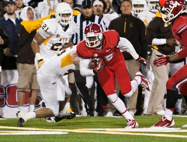 Fresno State widereceiver Devante Adams slips a tackle after catching a pass during the first half against the Wyoming Cowboys Saturday at War Memorial Stadium in Laramie, Wyo. (AP Photo/Jeremy Martin)