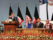 Former Afghan President Hamid Karzai, left, speaks on the last day of an Afghan Loya Jirga or traditional council, in Kabul, Afghanistan, Sunday, Aug. 9, 2020. The council concluded Sunday with hundreds of delegates agreeing to free 400 Taliban members, paving the way for an early start to negotiations between Afghanistan's warring sides. (AP Photo)