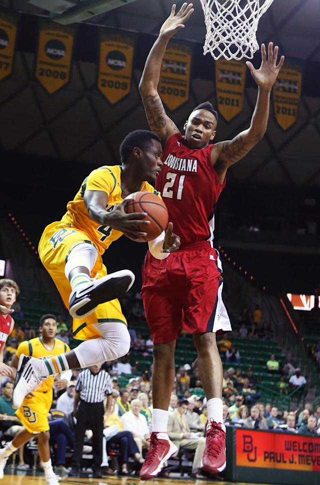 Baylor guard Gary Franklin (4) attempts to pass around Louisiana Lafayette forward Shawn Long (21), right, in the first half of an NCAA college basketball game, Sunday, Nov. 17, 2013, in Waco, Texas. (AP Photo/Waco Tribune Herald, Rod Aydelotte)