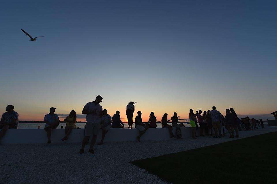 Beachgoers enjoy the sunset in Newport, Rhode Island. (Photo by Michael Loccisano/Getty Images for Pandora Media))