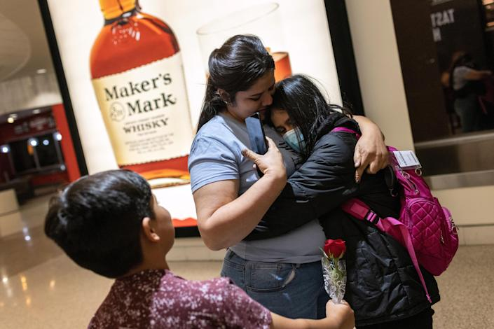 Honduran immigrant Nani, 10, is greeted by her extended family upon her flight's arrival on April 23, 2021 to Louisville, Kentucky. The unaccompanied minor had been released that day from U.S. Health and Human Services custody after spending nearly eight weeks in shelters Indiana. / Credit: Getty Images